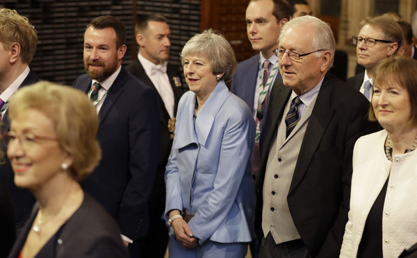 State Opening Of Parliament [theresa may,members,elizabeth ii,people,event,suit,white-collar worker,gesture,crowd,official,state opening of parliament,state opening,speech,parliament,parliament,commons members lobby,government]