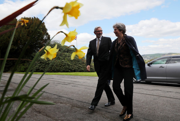 Theresa May Visits Oxley Group In Cumbria [yellow,suit,luxury vehicle,vehicle,car,vehicle door,flower,outerwear,plant,photography,theresa may,martin blakstad,sajid javid,amber rudd,part,cumbria,british,head office,oxley group,campaign]