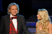"Thomas Gottschalk says good-bye to the audience while standing next to Michelle Hunziker during the 199th ""Wetten dass...?"" show at the Rothaus Hall on December 3, 2011 in Friedrichshafen, Germany. After 24 years host Thomas Gottschalk terminates today his career as ""Wetten dass...?"" moderator."