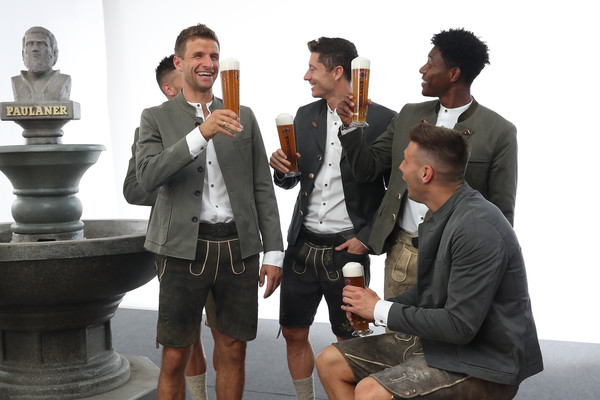 FC Bayern Muenchen And Paulaner Photo Session [white-collar worker,event,tourism,conversation,thomas mueller,niklas suele,david alaba,robert lewandowski,l-r,fc bayern muenchen,paulaner,fgv schmidtle studios,photo session,photo session]