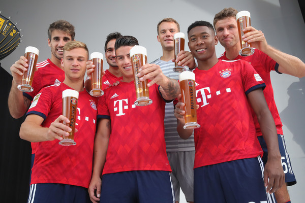 FC Bayern Muenchen And Paulaner Photo Session [team,social group,sports,team sport,youth,player,competition,championship,tournament,competition event,niko kovac,partner,javier martinez,joshua kimmich,l-r,germany,fc bayern muenchen,paulaner,football team,photo session]