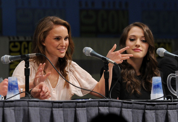 Actress Natalie Portman (L) and Kat Dennings speak at the Marvel Studios'