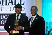 Rapper LL Cool J gets the scholarship named after him from President  & CEO of Thurgood Marshall College Fund Johnny C. Taylor Jr. at the Thurgood Marshall College Fund 26th Awards Gala at Washington Hilton on November 12, 2014 in Washington, DC.