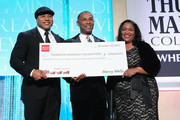 (L-R)  Rapper LL Cool J,  President  & CEO of Thurgood Marshall College Fund Johnny C. Taylor Jr. and Gigi Dixon of Wells Fargo present a check on stage at the Thurgood Marshall College Fund 26th Awards Gala at Washington Hilton on November 12, 2014 in Washington, DC.