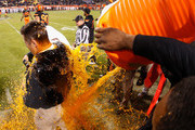 Head coach Mike Gundy of the Oklahoma State Cowboys is dunked with gatorade on the sidelines during the final moments of the TicketCity Cactus Bowl against the Washington Huskies at Sun Devil Stadium on January 2, 2015 in Tempe, Arizona. The Cowboys defeated the Huskies 30-22.