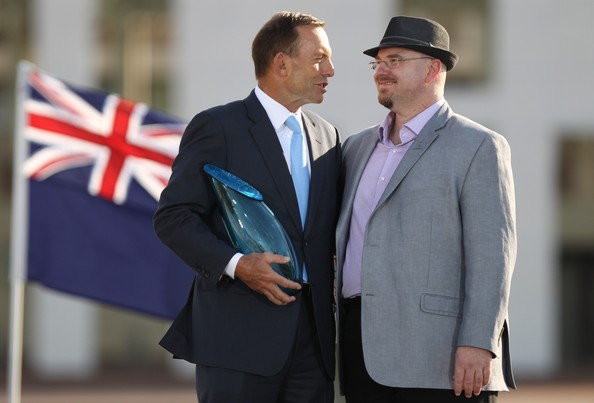2014 Australian Of The Year Announced In Canberra [suit,white-collar worker,event,gesture,official,formal wear,blazer,businessperson,flag,australian of the year,prime minister,tony abbott,tim conolan,award,contributions,local hero,canberra,australian,parliament house]
