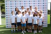 Nicole McGuinness, Lindsay Davenport, Tim Henman and Helen Parker with children from Give It Your Max during a Wimbledon press conference with a twist, on HSBC's Court 20 at Wimbledon on July 2, 2019 in London, England.