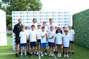 Lindsay Davenport and Tim Henman with children from Give It Your Max during a Wimbledon press conference with a twist, on HSBC's Court 20 at Wimbledon on July 2, 2019 in London, England.