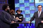 """(L-R) Questlove of The Roots, Singer/songwriter Tim McGraw, Black Thought of The Roots, and Comedian Steve Higgins play a trivia game on """"The Tonight Show Starring Jimmy Fallon"""" at Rockefeller Center on November 16, 2017 in New York City."""