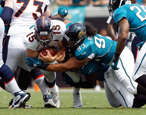 tim tebow tyson alualu 93 of the jacksonville jaguars tackles tim. Cars Review. Best American Auto & Cars Review