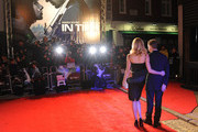 Rachel Roberts and Andrew Niccol attend the UK Premiere for 'In Time' at The Curzon Mayfair on October 31, 2011 in London, England.