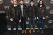 Jared Followill, Caleb Followill, Matthew Followill and Nathan Followill of Kings of Leon attend Time Warner Cable Studios Presents FOX Sports 1 Thursday Night Super Bash on January 30, 2014 in New York City.