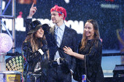 Richard Tyler Blevins (aka Ninja) (C) and Jessica Goch on stage during  the Times Square New Year's Eve 2019 Celebration on December 31, 2018 in New York City.