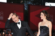 """Actor Gary Oldman and Alexandra Edenborough attend the """"Tinker, Tailor, Soldier, Spy"""" premiere at the Palazzo del Cinema during the 68th Venice Film Festival on September 5, 2011 in Venice, Italy."""
