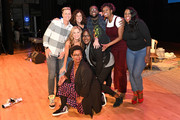 (L-R) Abby Wambach, Glennon Doyle, Jennifer Rudolph Walsh, Ashley C. Ford, Naomi Ekperigin, Michael Trotter, Amena Brown and Tanya Trotter pose on stage at Together Live at Taft Theatre on October 23, 2019 in Cincinnati, Ohio.