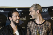 Tom Kaulitz (L) and Bill Kaulitz attend the Tokio Hotel Press Conference & Photocall on October 2, 2014 in Berlin, Germany. After a five year break, the new Tokio Hotel record 'Kings Of Suburbia' will be released on October 3.