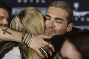 Bill Kaulitz hugs a fan after the Tokio Hotel Press Conference & Photocall on October 2, 2014 in Berlin, Germany. After a five year break, the new Tokio Hotel record 'Kings Of Suburbia' will be released on October 3.