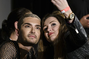 Bill Kaulitz poses with fan Aslihan Boruhan after the Tokio Hotel Press Conference & Photocall on October 2, 2014 in Berlin, Germany. After a five year break, the new Tokio Hotel record 'Kings Of Suburbia' will be released on October 3.
