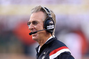 Tommy Tuberville the head coach of the Cincinnati Bearcats watches the action during the game against the Toledo Rockets at Paul Brown Stadium on September 12, 2014 in Cincinnati, Ohio.