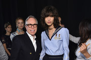 Designer Tommy Hilfiger and Mica Arganaraz backstage at the Tommy Hilfiger Women's  Fall 2016 show during New York Fashion Week: The Shows at Park Avenue Armory on February 15, 2016 in New York City.