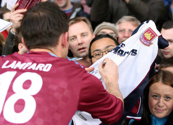 Frank Lampard Frank Lampard of the Academy All-Stars sign a West Ham shirt during the Tony Carr Testimonial match between the Academy All-Stars and West Ham United at the Boleyn Ground on May 05, 2010 in London, England.