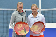 Winner Petra Kvitova of Czech Republic (L) and runner-up Angelique Kerber of Germany celebrate with their plates after their women's singles final match during day seven of the Toray Pan Pacific Open at Ariake Colosseum on September 28, 2013 in Tokyo, Japan.