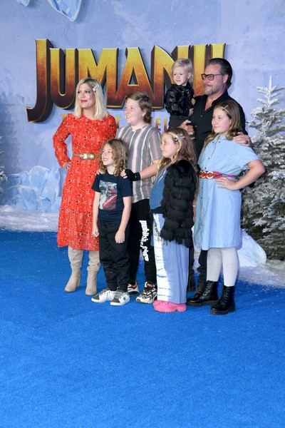 """Premiere Of Sony Pictures' """"Jumanji: The Next Level"""" - Arrivals [jumanji: the next level,child,fun,event,leisure,vacation,family,tourism,performance,arrivals,family,tori spelling,tcl chinese theatre,california,hollywood,sony pictures,premiere,premiere]"""