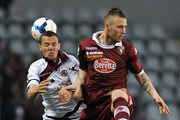 Jasmin Kurtic (R) of Torino FC goes up with Djamel Mesbah of AS Livorno Calcio during the Serie A match between Torino FC and AS Livorno Calcio at Stadio Olimpico di Torino on March 22, 2014 in Turin, Italy.