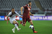 Nikola Maksimovic (R) of Torino FC in action against Djamel Mesbah of AS Livorno Calcio during the Serie A match between Torino FC and AS Livorno Calcio at Stadio Olimpico di Torino on March 22, 2014 in Turin, Italy.