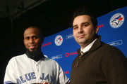 Jose Reyes #7 of the Toronto Blue Jays shakes hands with general manager Alex Anthopoulos after concluding his press conference at Rogers Centre on January 17, 2013 in Toronto, Ontario.