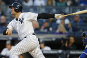 Matt Holliday #17 of the New York Yankees hits a three-run home run in the first inning against the Toronto Blue Jays during a game at Yankee Stadium on May 3, 2017 in the Bronx borough of New York City.