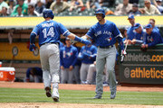 Justin Smoak #14 of the Toronto Blue Jays is congratulated by Troy Tulowitzki #2 after he hit a home run against the Oakland Athletics in the second inning at Oakland Alameda Coliseum on June 7, 2017 in Oakland, California.