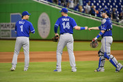 Aledmys Diaz, Justin Smoak #14, and Danny Jansen #9 of the Toronto Blue Jays celebrate the win against the Miami Marlins at Marlins Park on August 31, 2018 in Miami, Florida.