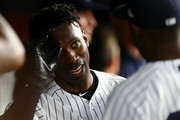 Andrew McCutchen #26 of the New York Yankees celebrates in the dugout after hitting a home run in the fifth inning against the Toronto Blue Jays at Yankee Stadium on September 14, 2018 in the Bronx borough of New York City.