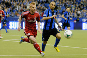 Marco Di Vaio #9 of Montreal Impact and Richard Eckersley #27 of Toronto FC chase the ball during the MLS game at the Olympic Stadium on March 16, 2013 in Montreal, Quebec, Canada.
