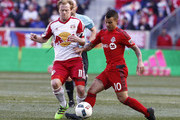 Dax McCarty #11 of New York Red Bulls fights for the ball with Sebastian Giovinco #10 of Toronto FC during their match at Red Bull Arena on March 6, 2016 in Harrison, New Jersey.