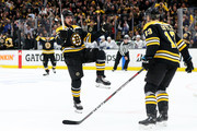 Marcus Johansson #90 of the Boston Bruins celebrates with Charlie Coyle #13 after scoring a goal against the Toronto Maple Leafs during the first period of Game Seven of the Eastern Conference First Round during the 2019 NHL Stanley Cup Playoffs at TD Garden on April 23, 2019 in Boston, Massachusetts.