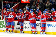 MONTREAL- APRIL 10:  Members of the Montreal Canadiens celebrate the first period goal by Andrei Markov #79 during the NHL game against the Toronto Maple Leafs on April 10, 2010 at the Bell Centre in Montreal, Quebec, Canada.