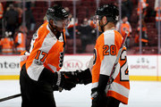 Wayne Simmonds #17 of the Philadelphia Flyers and Claude Giroux #28 celebrate the win over the Toronto Maple Leafs after the game on December 12, 2017 at Wells Fargo Center in Philadelphia, Pennsylvania.The Philadelphia Flyers defeated the Toronto Maple Leafs 4-2.
