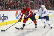 Devante Smith-Pelly #25 of the Washington Capitals skates past Nikita Zaitsev #22 of the Toronto Maple Leafs during the second period at Capital One Arena on October 13, 2018 in Washington, DC.