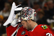 Cam Ward #30 of the Chicago Blackhawks adjusts his mask during the regular season opening home game against the Toronto Maple Leafs at the United Center on October 7, 2018 in Chicago, Illinois. The Maple Leafs defeated the Blackhawks 7-6 in overtime.