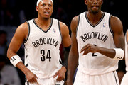 Paul Pierce #34 and Kevin Garnett #2 of the Brooklyn Nets walks on the court in the first half against the Toronto Raptors in Game Three of the Eastern Conference Quarterfinals during the 2014 NBA Playoffs at the Barclays Center on April 25, 2014 in the Brooklyn borough of New York City. NOTE TO USER: User expressly acknowledges and agrees that, by downloading and/or using this photograph, user is consenting to the terms and conditions of the Getty Images License Agreement.