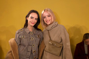 Olivia Perez  (L) and Charlotte Groeneveld attend the Tory Burch Fall Winter 2020 Fashion Show at Sotheby's on February 09, 2020 in New York City.