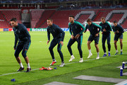 Tottenham Hotspur players warm up during a training session ahead of their UEFA Champions League Group B match against PSV at Philips Stadion on October 23, 2018 in Eindhoven, Netherlands.