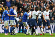 Joe Ralls of Cardiff City receives a red card from match referee Mike Dean during the Premier League match between Tottenham Hotspur and Cardiff City at Tottenham Hotspur Stadium on October 6, 2018 in London, United Kingdom.