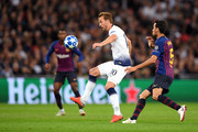 Harry Kane of Tottenham Hotspur and Sergio Busquets of Barcelona in action during the Group B match of the UEFA Champions League between Tottenham Hotspur and FC Barcelona at Wembley Stadium on October 3, 2018 in London, United Kingdom.