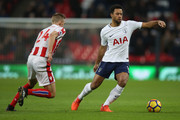 Mousa Dembele of Tottenham Hotspur breaks away from Darren Fletcher of Stoke City during the Premier League match between Tottenham Hotspur and Stoke City at Wembley Stadium on December 9, 2017 in London, England.