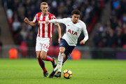 Dele Alli of Tottenham Hotspur gets away from Darren Fletcher of Stoke City during the Premier League match between Tottenham Hotspur and Stoke City at Wembley Stadium on December 9, 2017 in London, England.