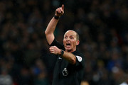 Referee Mike Dean gives intructions during the Premier League match between Tottenham Hotspur and West Ham United at Wembley Stadium on January 4, 2018 in London, England.
