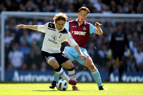 Luka Modric (L) of Tottenham Hotspur battles for the ball with Scott Parker of West Ham during the Barclays Premier League match between Tottenham Hotspur and West Ham United at White Hart Lane on March 19, 2011 in London, England.